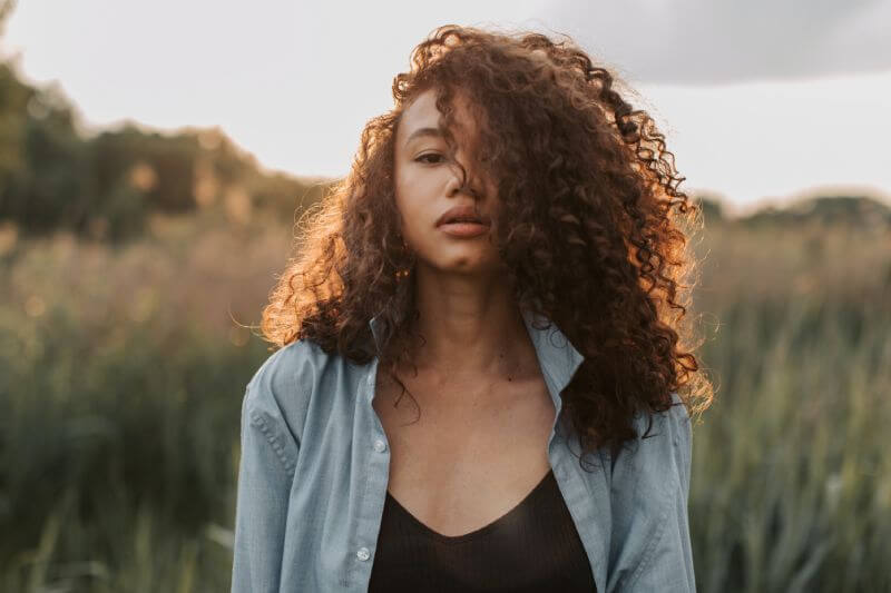 curly hairstyle with moringa oil